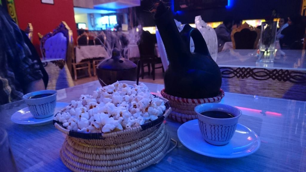 Etiopean coffee served with popcorn at Horn of Africa.