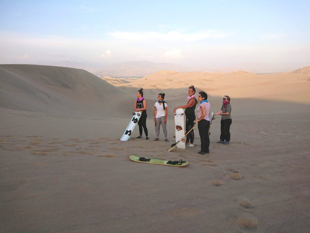 Waiting for the next sandboarder to run down the dune. The tourist route Huacachina Oasis, Peru.